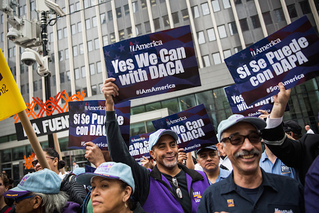 "NEW YORK, NY - MAY 19:  Activists calling for federal judges to reject challenges to President Obama's ""Deferred Action for Parents of Americans and Lawful Permanent Residents"" (DAPA) program protest outside the Jacob K. Javits Federal building, where naturalization ceremonies take place, on May 19, 2015 in New York City. DAPA, which has come under fire from conservatives, would create a system which would stop the deportation of certain immigrants who entered to U.S. illegally.  (Photo by Andrew Burton/Getty Images)"