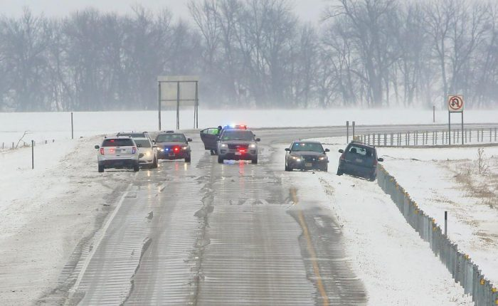 Law enforcement vehicles park and block westbound traffic along Interstate 94 just east of Moorhead as officials investigate an active scene on Monday, March 5, 2018. David Samson / The Forum