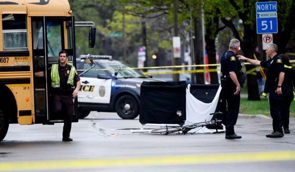 St. Paul Police investigators work the scene of a fatal bicycle accident in St. Paul, Minn. on Wednesday, May 9, 2018. St. Paul police are investigating a fatal crash Wednesday involving a bicyclist and school bus at the intersection of Snelling and Summit avenues. No students on the bus were injured, but the cyclist was killed, according to police. The bus was carrying about 30 students from Ramsey Middle School, said St. Paul Public Schools spokeswoman Toya Stewart Downey. (John Autey / Pioneer Press)