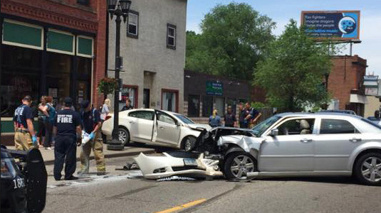 After it was reported that someone in one vehicle shot at another vehicle, one of the vehicles drove away and crashed into an uninvolved vehicle on St. Paul's Rice Street in the area of Winnipeg Avenue on Thursday, June 7, 2018. No one was injured in the shooting. Paramedics examined one woman at the scene and took another woman to the hospital for evaluation. (Courtesy of Gidget Bailey)
