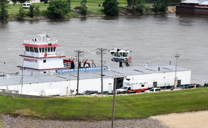 An ambulance was seen near the Mississippi River on Thursday, June 20, after two juveniles were rescued from the river. (Mara H. Gottfried / Pioneer Press)